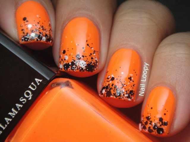 оранжевый маникюр ногтей чёрный кончик