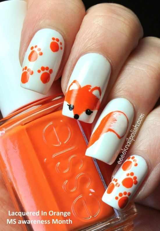 оранжевый маникюр ногтей лиса