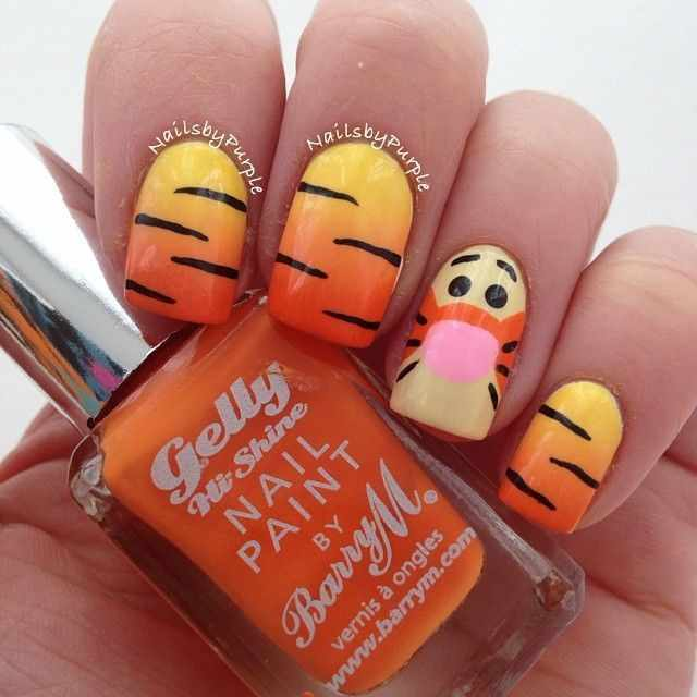 оранжевый маникюр ногтей тигра