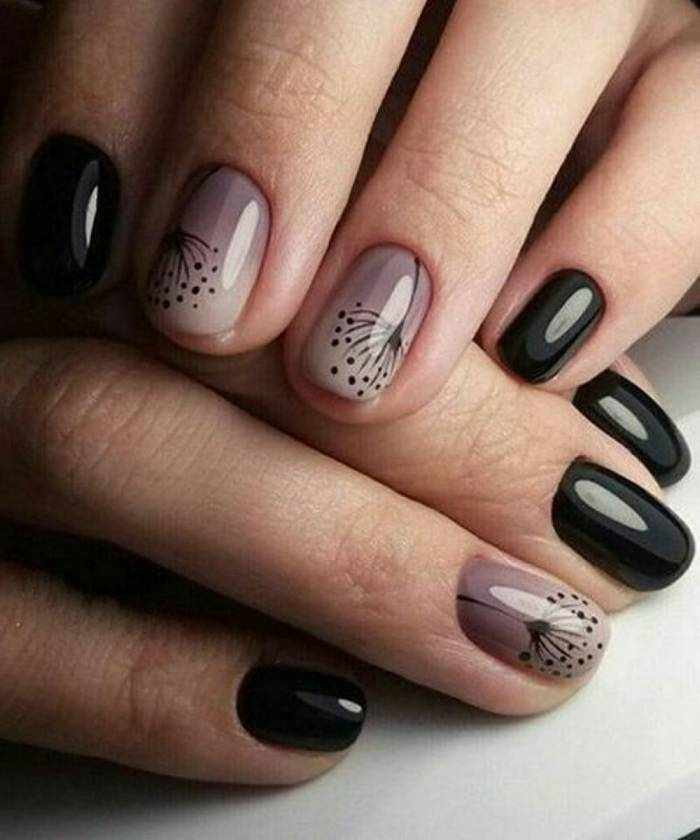 Рисунки на ногтях в черном маникюре